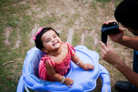 indian summer: man taking pictures of his daughter