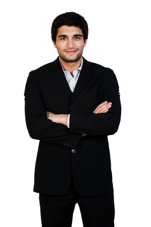 young happy business man standing with his arms crossed isolated on white