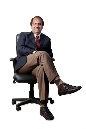 happy and confident senior businessman sitting in the office chair isolated on white background photo