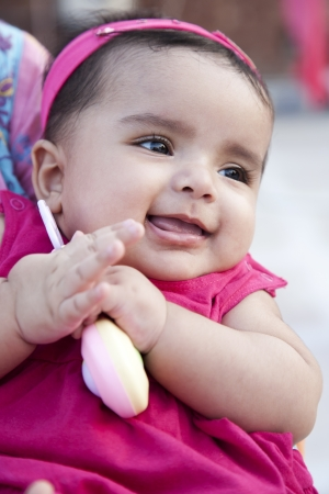 closeup of a little indian girl with a smile.
