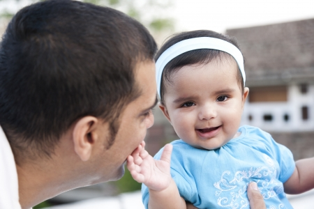 south asian ethnicity: Portrait of a father and the baby girl Stock Photo