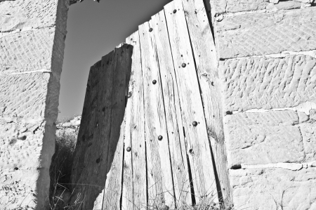 rickety: Old rickety door in black and white