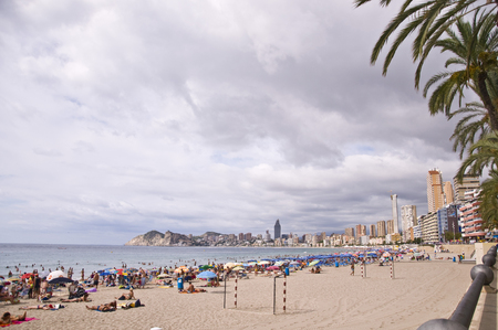 almost all: BENIDORM, SPAIN - September 13, 2013  Poniente beach in Benidorm  Benidorm is one of the main destinations in the Mediterranean coast of Spain, almost during all the year it has visitors from different countries
