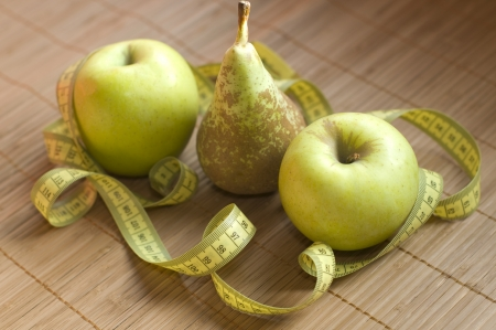 metric: Apple and metric ribbon, food for a healthy lifestyle