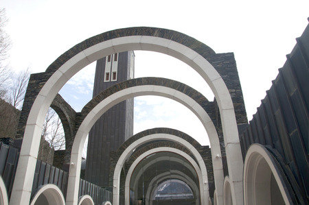 tourism in andorra: The Sanctuary of Nostra Senyora de Meritxell, located in Andorra, is the work of the architect Ricard Bofill. Stock Photo