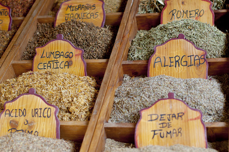 teas: Herbal teas in a fair stand labeled in Spanish.