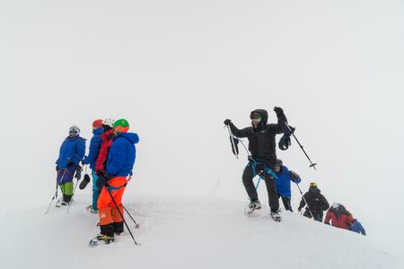 Caucasus / Russia - 07.15.2018 Group of climbers climbing mountain peaks.