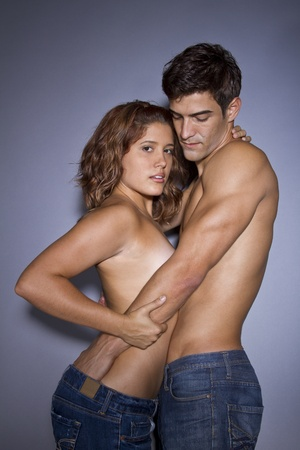 undressed: in studio shot of a couple in the throws of lust