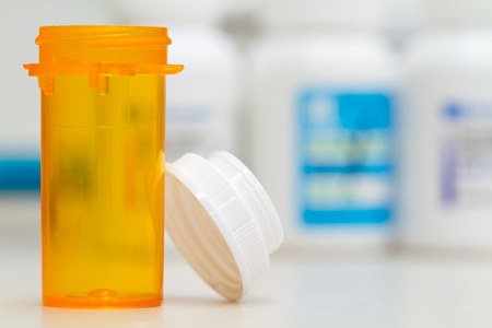 refill: pharmacy vial, with pill bottle background, generic cap Stock Photo