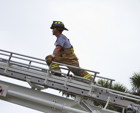 fireman at scene on ladder photo