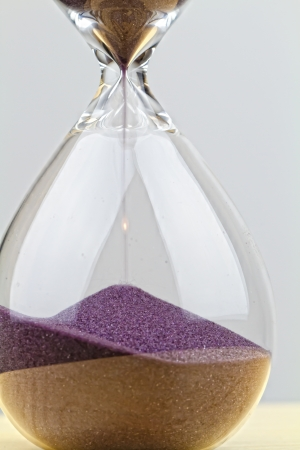 sand grains: hourglass on white Stock Photo