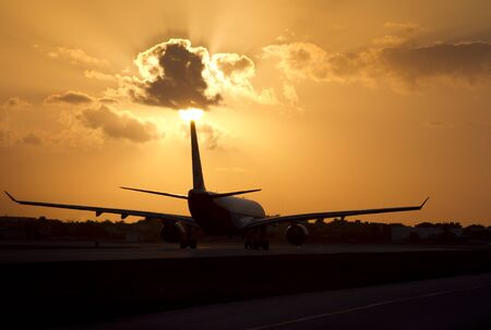 airplane at sunset vacation flight Stock Photo