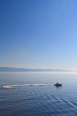 small boat on open waters Stock Photo
