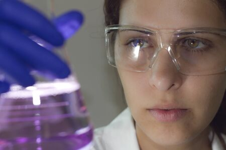 lab scientist holding a beaker Stock Photo