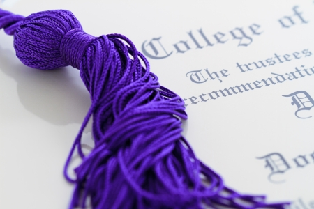graduation tassle on a diploma Stock Photo