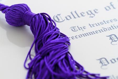 graduation tassle on a diploma Banco de Imagens