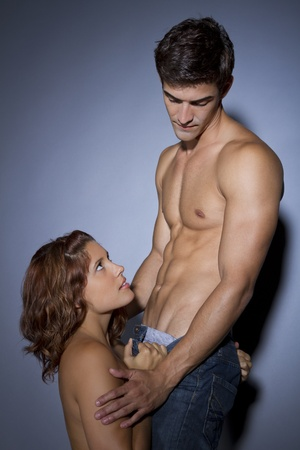sex couple: young couple in seductive pose