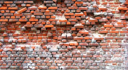 rick: old red brick wall with displaced bricks