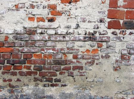 crannied plaster on red brick wall Stock Photo - 7123592