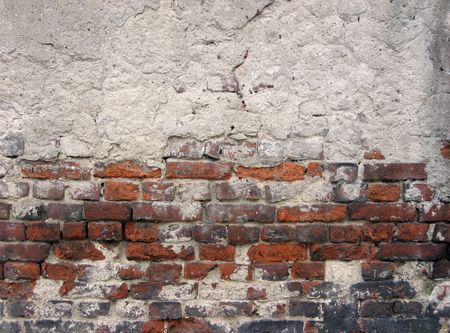 dint: crannied plaster on red brick wall