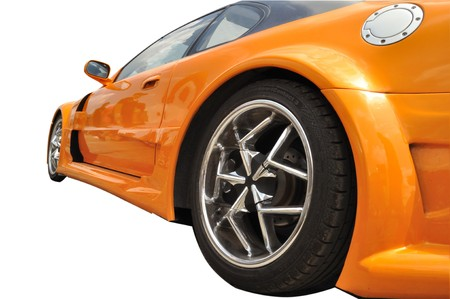 orange extreme car with modern wheel rims on white background