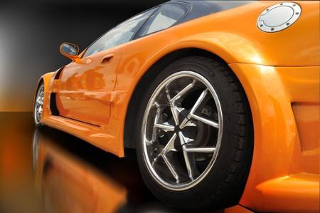 extreme orange car with modern wheel rims