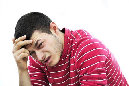 young man having headache Stock Photo - 8675492