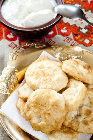 Batter fried in deep oil with sugar powder and yoghurt - Bulgarian breakfast