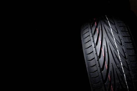 close up of new sport summer tire, over black, studio shot