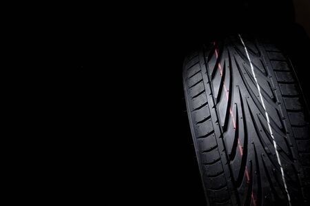 tyre tread: close up of new sport summer tire, over black, studio shot