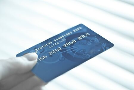 fingers holding credit card Stock Photo - 9600788