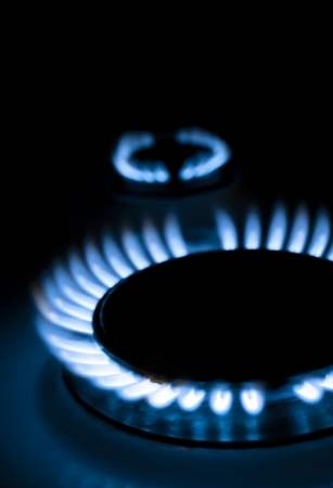 gas cooker: blue flames of gas stove in the dark