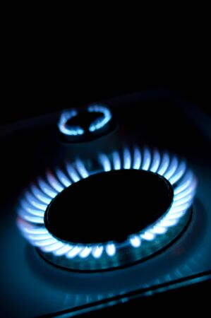 blue flames of gas stove in the dark Stock Photo - 9789866