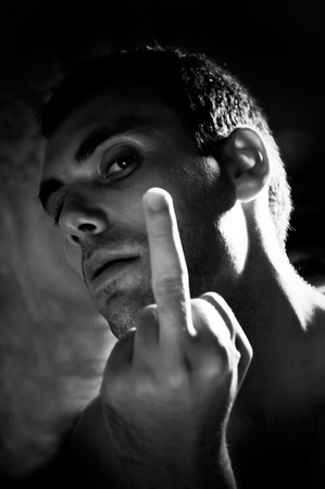 sexy man showing middle finger photo