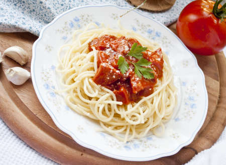 spaghetti with tomato sauce and ingredients Stock Photo - 9966279