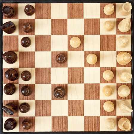 chellange: chessboard and first moves in game Stock Photo