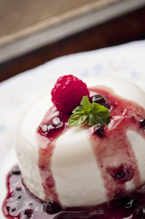 italian panna cotta dessert with fresh berries  photo