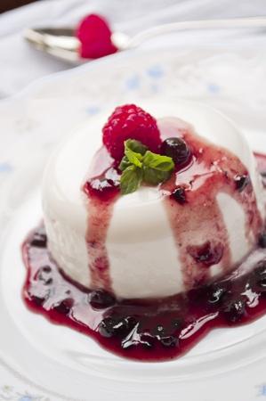 italian panna cotta dessert with fresh berries