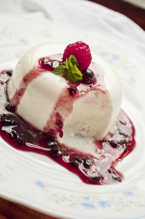 italian panna cotta dessert with fresh berries  photo