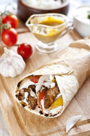 tortilla with chicken meat, fries and basil Stock Photo