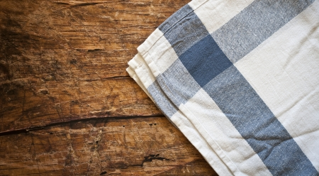 Tablecloth on wooden table background Stock Photo - 19942313