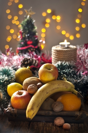 Christmas fruit decoration on table photo