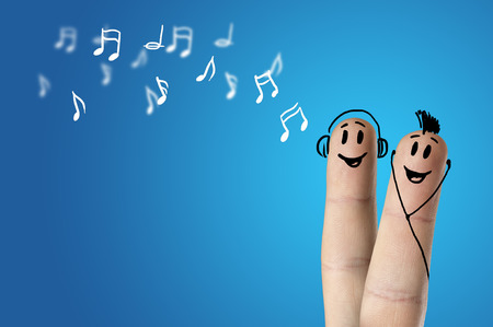 happy finger couple listening to music
