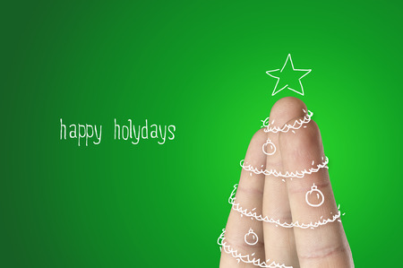 Christmas finger tree on green backgound photo