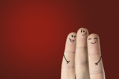 happy fingers on colored background photo