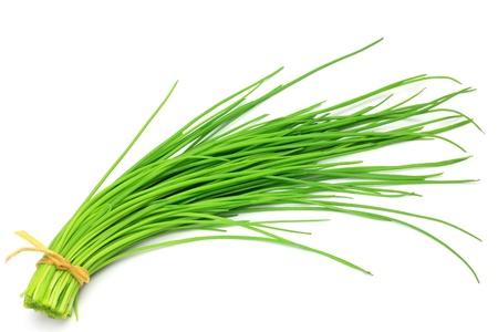Ho preso il mazzetto di erba cipollina in uno sfondo bianco. Archivio Fotografico