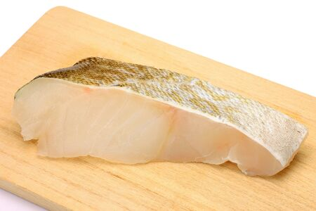fishery products: I put the slice of the cod on the cutting board and I took it in a white background.