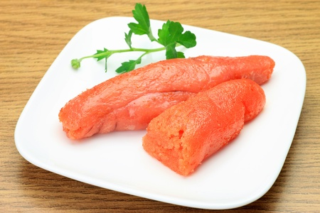 This is called mentaiko with the thing which added a red pepper to a cod roe. This is a Japanese dish. Stock Photo
