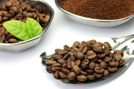 I put coffee beans in tableware and I took it in a white background  photo