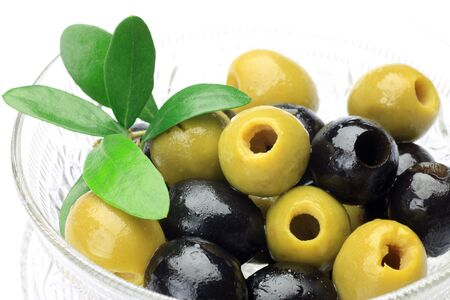 glasswork: I put  green olive and black olive in a glasswork and I took it in a white background  Stock Photo